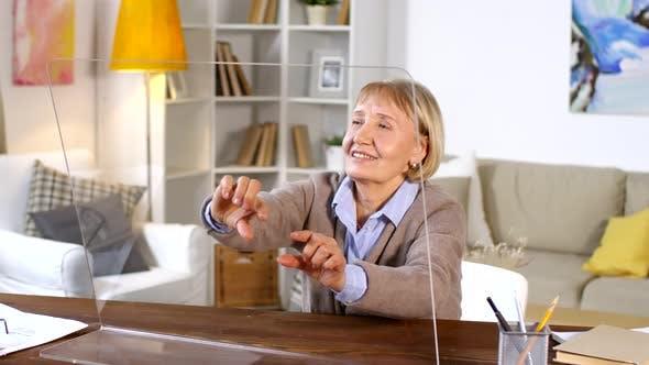 Cover Image for Senior Woman Using Transparent AR Computer