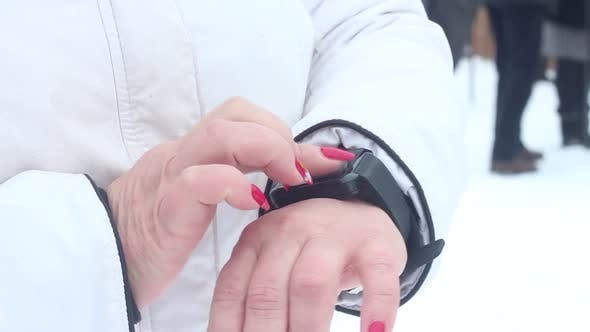 Thumbnail for Woman Is Using Smart Watch
