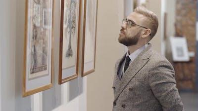 Man Looking at Artwork in Museum