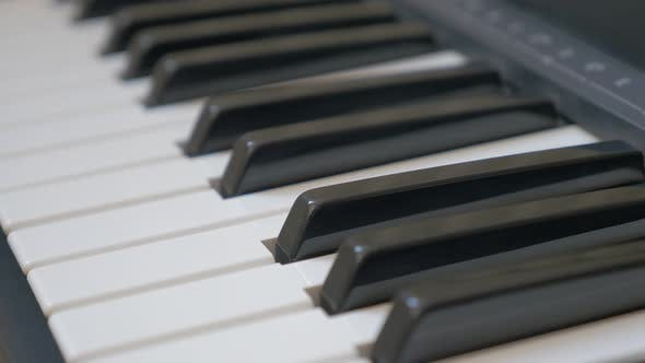 Thumbnail for Electric piano keys close-up panning 4K 2160p UHD footage - Electric piano black and white  keyboard