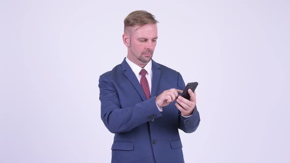 Thumbnail for Happy Blonde Businessman Using Phone and Getting Good News