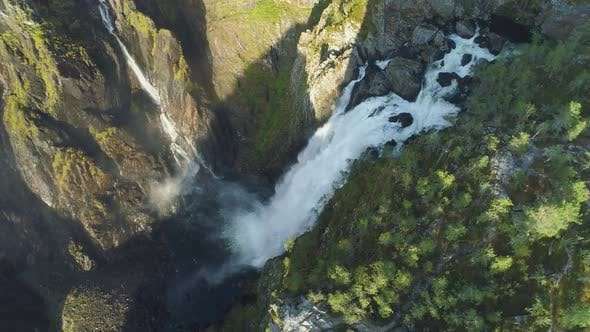 Thumbnail for Voringfossen Waterfall and Cliffs with Green Trees in Norway at Sunny Summer Day. Aerial View