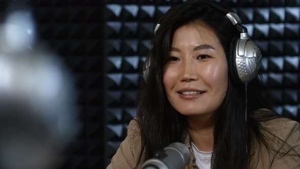 Thumbnail for Asian Woman Talking on Radio Show