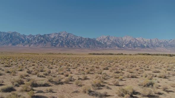 4K Aerial Steppe & Mountain Range