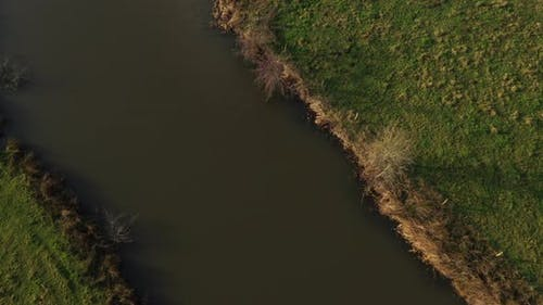 Aerial - A meandering river showing an agricultural landscape in europe