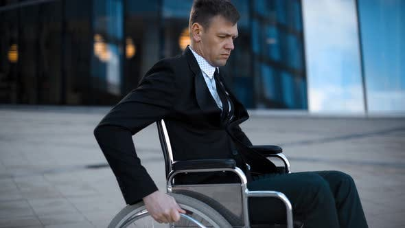 Thumbnail for Disabled Invalid Entrepreneur Unfolds on Wheelchair Outdoor