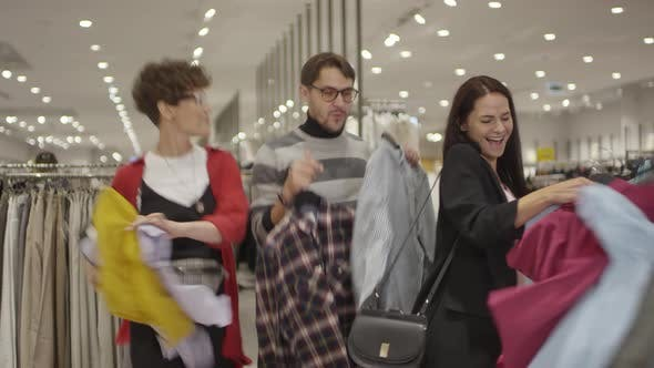 Happy People Shopping for Clothes