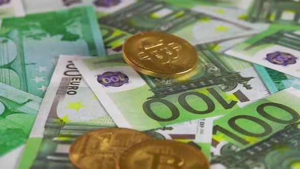 Bitcoin Falls on a Bunch of 100 Euro Banknotes