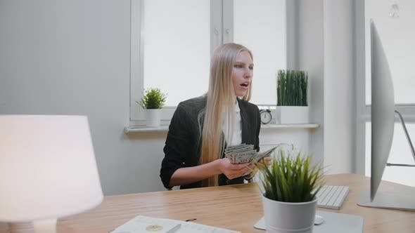 Woman Celebrating Success in Office