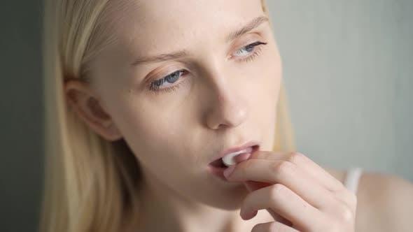 Pregnant Woman Taking Medicine Painkiller Pills Pouring on Female Hand Capsules From Meds Bottle
