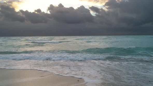 Thumbnail for Ocean Waves Crashing On Beach At Sunrise Or Sunset Moody Clouds