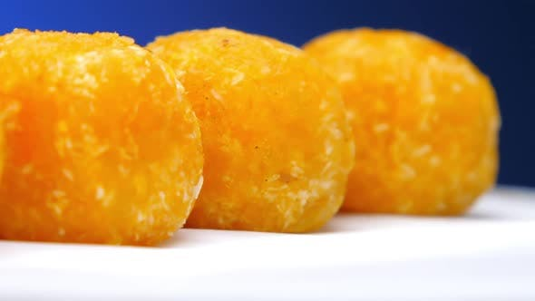 Delicious Caramel Sweets of Yellow Colour Lie on Row