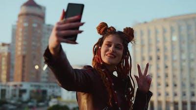 Happy Woman Making Selfie on Cellphone Outside