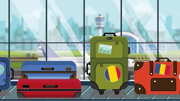 Suitcases with Romanian Flag Stickers on Baggage Carousel