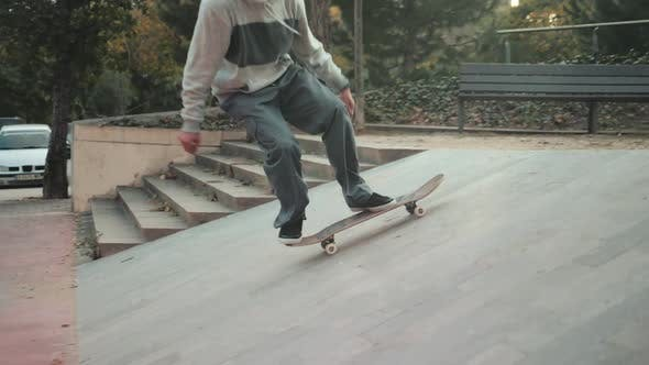 Cover Image for Professional Skater Jump with Kickflip Flip Trick on Board, Skateboarder Ollie, Skateboarding