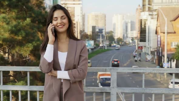Thumbnail for Beautiful Brunette Businesswoman In Business Clothes Walks In The City