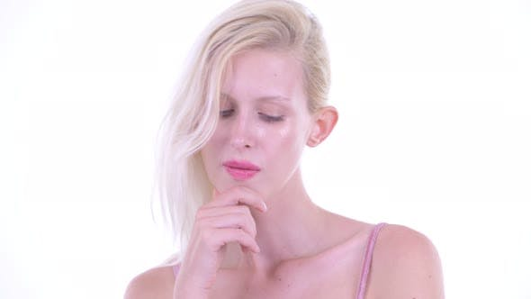 Thumbnail for Face of Stressed Young Blonde Woman Thinking and Looking Down