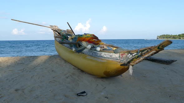 Thumbnail for Traditional yellow catamaran fishing boat at the beach