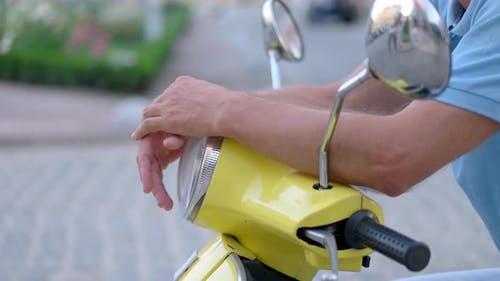 Hands on Motorbike Steering Wheel.