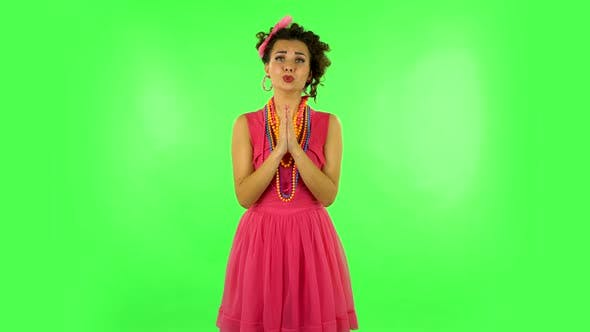 Thumbnail for Girl Keeps Palm Together and Asks for Something Isolated. Green Screen