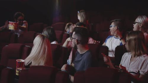 Man Spoiling Movie for Fellow Moviegoers in Cinema