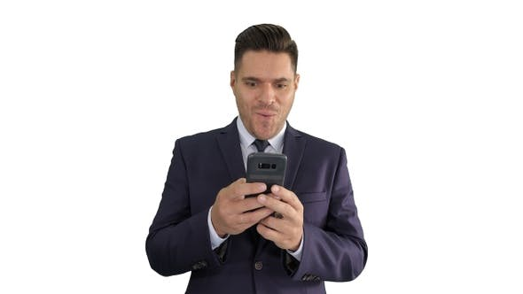 Cover Image for Businessman looking at smartphone with surprise expression