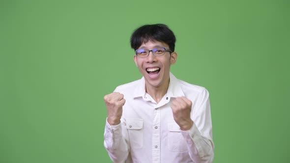 Thumbnail for Young Happy Asian Businessman Smiling and Excited