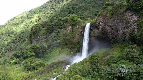 Still video and panning shot of a large waterfall near Banos, Ecuador