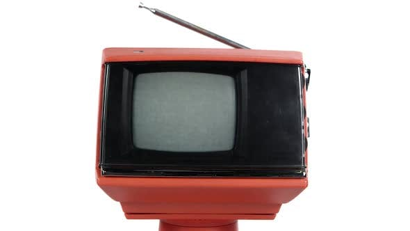 Thumbnail for View of old TV turning on to static after warming up