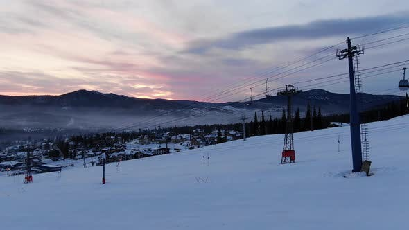 Thumbnail for Poma Lift Transports Cabins Over Snowy Mountain Slope