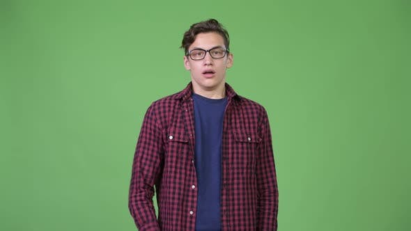 Thumbnail for Young Handsome Teenage Nerd Boy Looking Shocked