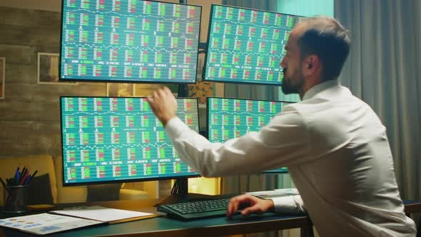 Financial Consultant Checking the Exchange Market