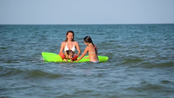 Thumbnail for Happy Woman with Children Splashing on the Water Surf