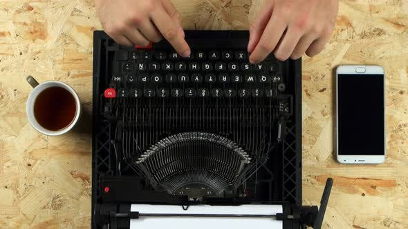 Thumbnail for Male Hands Typing on the Typewriter. View From Above