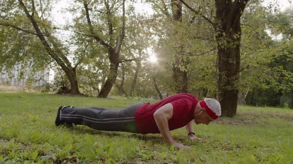 Thumbnail for Elderly Sporty Man Doing Push Up Exercises. Workout Cardio Outside in City Park at Morning