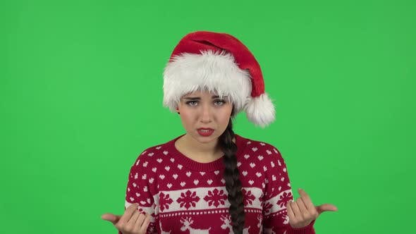 Thumbnail for Portrait of Sweety Girl in Santa Claus Hat Is Showing Gesture Come Here. Green Screen