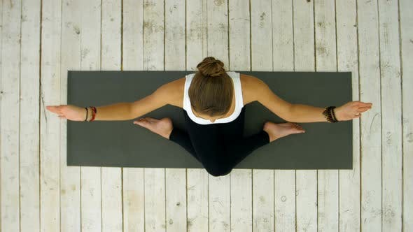 Thumbnail for Sporty Beautiful Young Woman Practicing Yoga, Sitting in Cross Legged Position