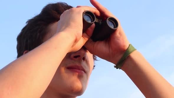 Thumbnail for Looking Through Binoculars.