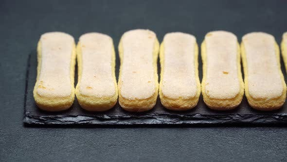 Cover Image for Italian Savoiardi Ladyfingers Biscuits on Concrete Background