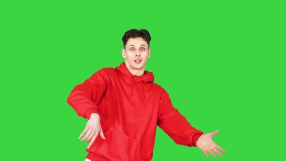 Thumbnail for The Cute Young Man Telling a Story To the Camera on a Green Screen, Chroma Key.
