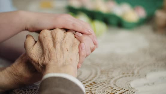 Woman Comforting Wrinkled Old Hand