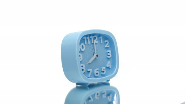 Thumbnail for Blue Alarm Clock Showing Eight O'clock Spinning Rotating 360 Isolated on White