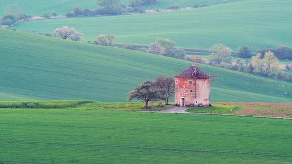 Picturesque Rural Landscape with Old Windmill
