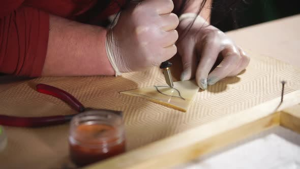 Cutting Ornament on Stained Glass