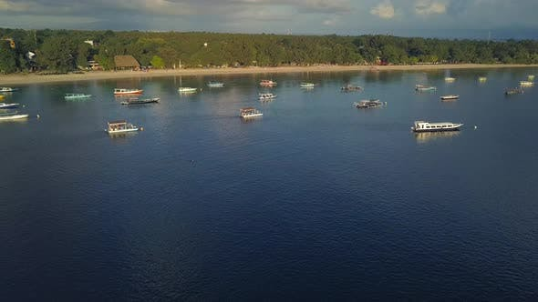 Tropical Island Aerial. Lombok, Gili. Beautiful Overview of the Boats on Water Near Coastal Line