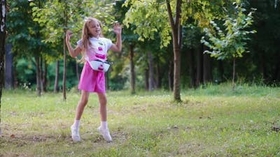 Child girl and nature park. View of little girl having fun on outdoor