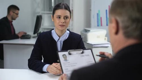 Hiring Manager Marking Resume of Unconfident Female Candidate, Hiring at Work