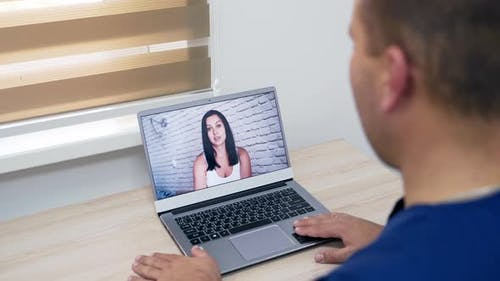 Male doctor delivering telemedicine consultation to a patient
