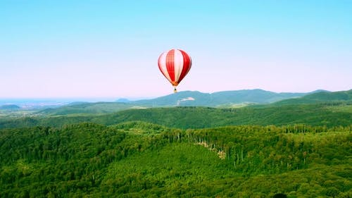 Hot-air Balloon with Passengers in the Sky