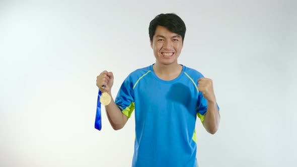 Man Cheering With His Golden Medal